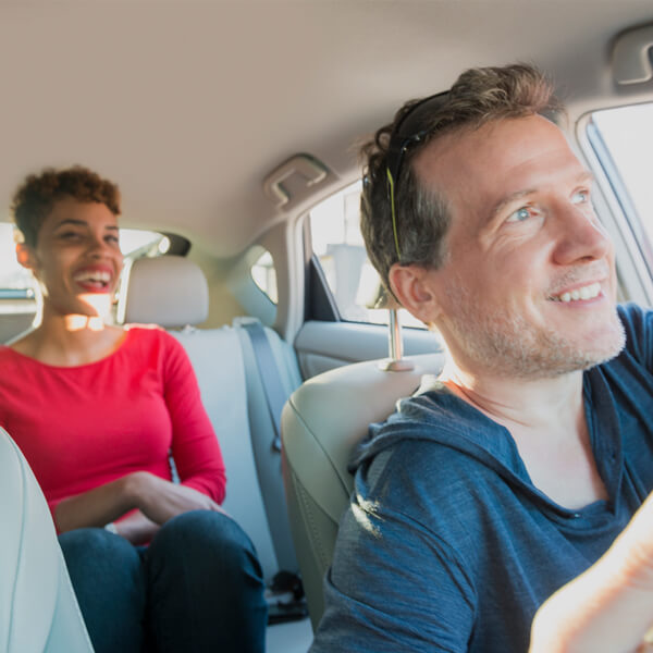 people riding in a lyft car.